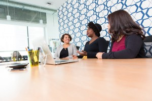 Three women of colour having a meeting in a boardroom